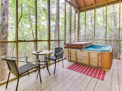 Photo for Dog-friendly log cabin w/ in-room Jacuzzi, screened-in deck, & outdoor hot tub