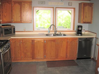 Furnished kitchen including dishwasher, microwave and coffee pot