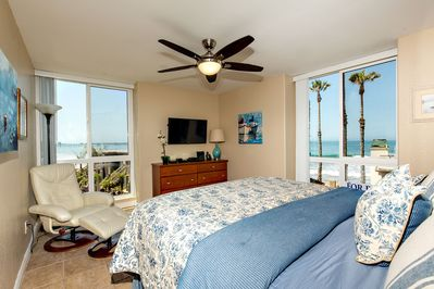 The romantic master retreat has two panoramic ocean view windows.