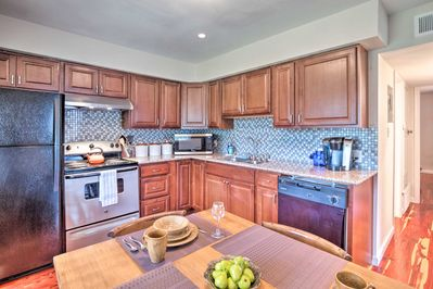 The fully equipped kitchen is completely updated with modern appliances.