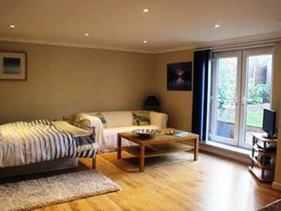 Photo for BOURNECOAST: Studio flat - walking distance to beach - ideal for couples -FM6033