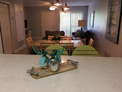Photo for Ground floor condo with great pools and across from white sand beaches!