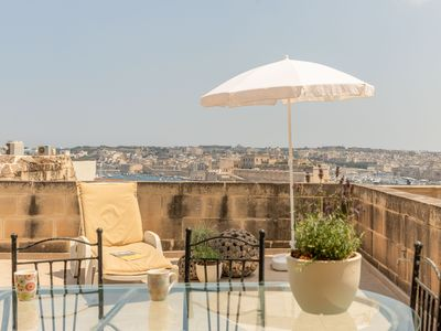 Photo for Beautiful apartment, Valletta, stunning views, 50sq/m terrace, fully A/C