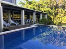 Deep shaded patio for relaxed pool lounging