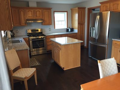 Remodeled fully equipped kitchen. Refrigerator, gas stove, dishwasher, microwave