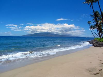 Puamana Beach with warm tropical water and views of Lanai