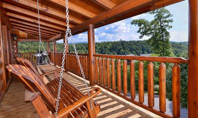 Wrap around porch with hand made swing looking out onto beautiful mountain views
