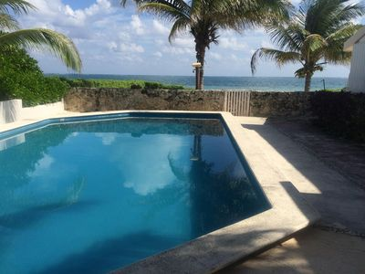 Ocean-front condo $900-$1125 per week, quiet with pool and secluded beach area