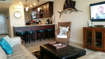 Newly redone condo with spectacular 5th floor open bay view.