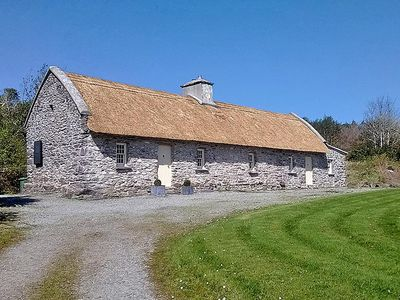 Photo for Authentic, renovated 400 year old stone/thatched cottage set in peaceful mountain location wit…