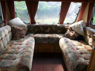 Seating area. ( Can be converted into either 2 single beds or one large double b