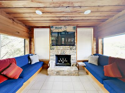 """Living Room - Sunken living room with seating for 6 and a 55"""" flat screen TV. (Please note that fireplace is not operational.)"""