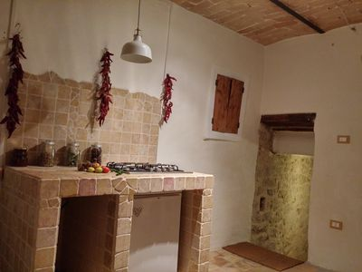 Photo for Small detached stone house with unique views of the Orta Valley