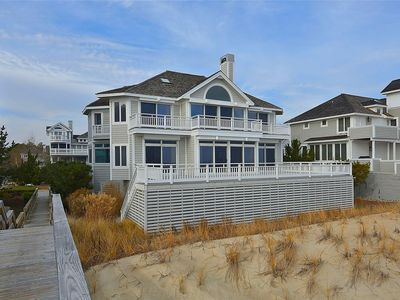 Photo for FREE ACTIVITIES!! The ultimate beach vacation is here! This spectacular beach front home features 5 bedrooms with 6.5 bathrooms