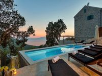 A beautifully decorated house in the hills with a stunning view down to the sea
