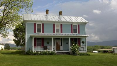 The farm house, recently painted light blue.