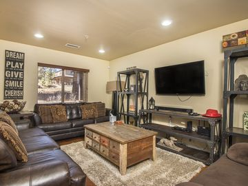 Family room fun with WIFI wide screen smart TV and sleeper sofa with topper