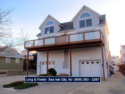 Photo for Spacious deck with bay and ocean views. Beautiful Townsend inlet townhouse.