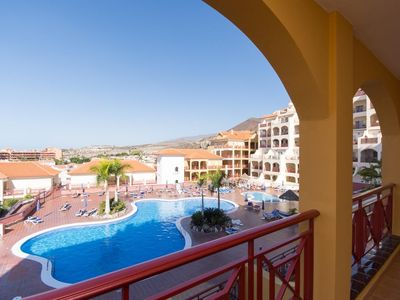 Photo for Holiday Apartment Los Cristianos with Mountain View, Wi-Fi, Balcony & Shared Pool; Street Parking Available