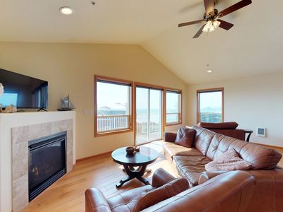 Photo for NEW LISTING! Spacious condo w/partial ocean view & fireplace -walk to the beach!