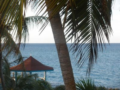 Photo for Romantic condo with loft -  private beach, Gazebo, pool, wifi, 24 hr security