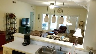 Kitchen, dining, and living area.