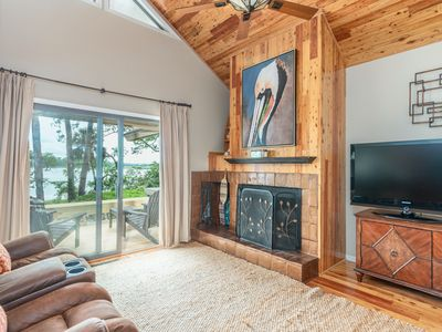 Photo for Updated three bedroom villa with movie room and serene marsh views