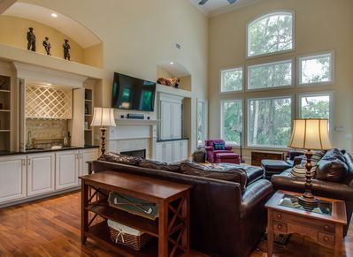 Living Room with Pool and Golf Course Views at 18 Heath