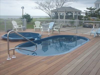Pool with views of water. Steps from the Bay Beaches.