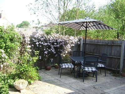 Rear garden with table and chairs.
