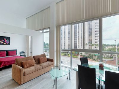 Photo for Light-filled condo with beach access and a shared pool, gym, and tennis!