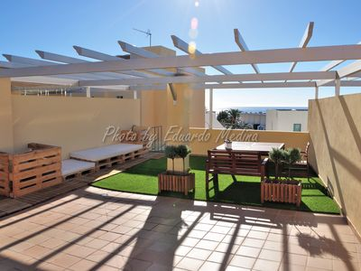 Photo for Nice apartment with huge terrace 100 meters from the beach. Free garage