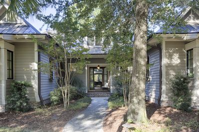 Stroll past the palmettos and oaks to the front door.