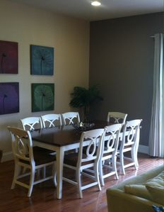 Dining room with seating for 8; adjacent additional seating for 4.