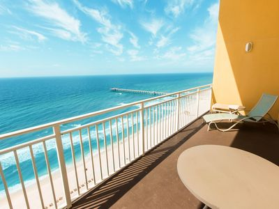 Photo for Beachfront condo w/ private furnished balcony - pool on-site