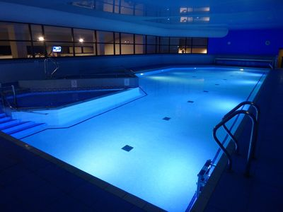 18m heated pool at the leisure next door - 100 yards away.