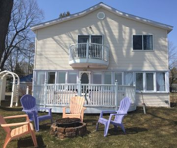 Lakefront view * all windows living room, two furnished decks & fire bowl