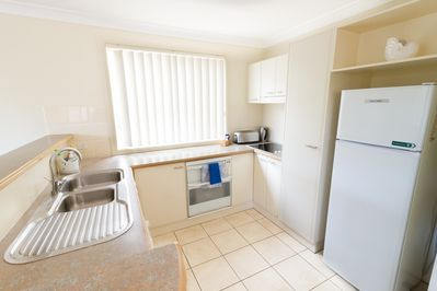 Full kitchen including dishwasher, microwave and appliances.