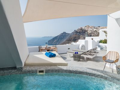Photo for Spacious luxury villa in the heart of Fira with amazing sea & sunset view