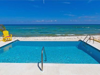Photo for Coral Cottage Yellow: A Scuba Diver's Paradise with Infinity Pool & Ocean Reef Walls