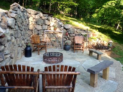 Stone remains of an old barn foundation make a great sitting area.