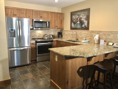 Kitchen with new granite countertops and appliances spring of 2018.