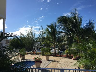 Photo for SOMBRERO BEACH PARADISE - GORGEOUS NEW WATERFRONT 4 BDR POOL, DOCK, PALMS & SAND
