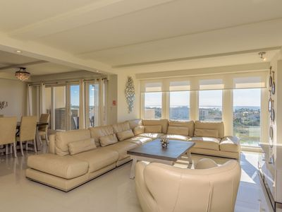 Photo for 4BR bayview for large families! Beachfront resort, shared pools & jacuzzi