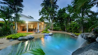 """View across pool to the outdoor entertaining area of """"Sandwater""""."""