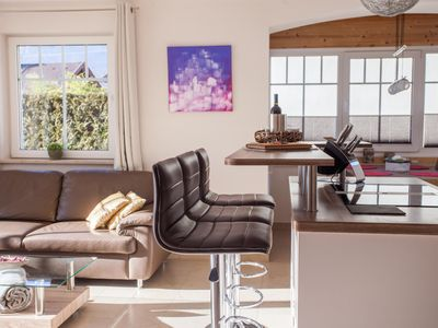 """Photo for Barrier-free holiday apartment """"Lebenslust"""" or """"A love of life"""" in Farchant for four people. Fantastic view of the mountains, kitchen island, terrace and séparée"""