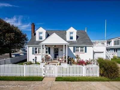 Photo for Fenced yard, patio, front porch, parking for 2 cars. ONLY one street to cross to access the beach & 3 blocks to the bay.