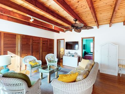 Photo for Adorable, sunny cottage w/ a full kitchen & furnished deck - walk to the beach!