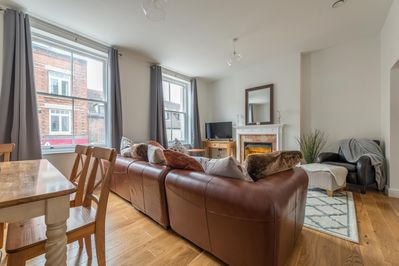 Spacious lounge with large comfy sofa