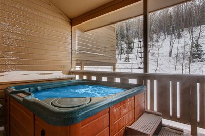 Hot Tub - Slide into the bubbling hot tub after a fun day of alpine adventure.